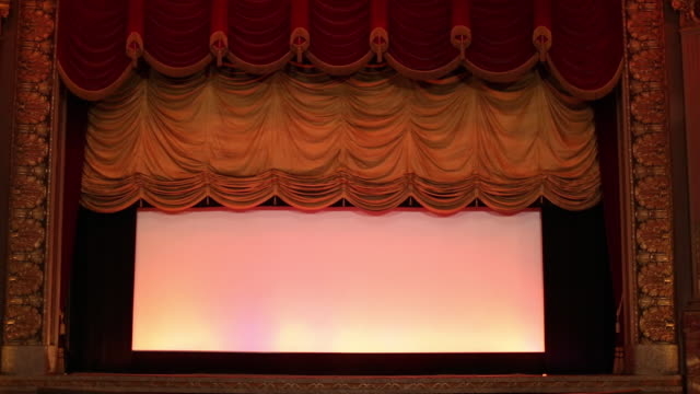 vídeos y material grabado en eventos de stock de ws interior of historic movie theater, stage curtain falls / richmond, virginia, usa - cerrado