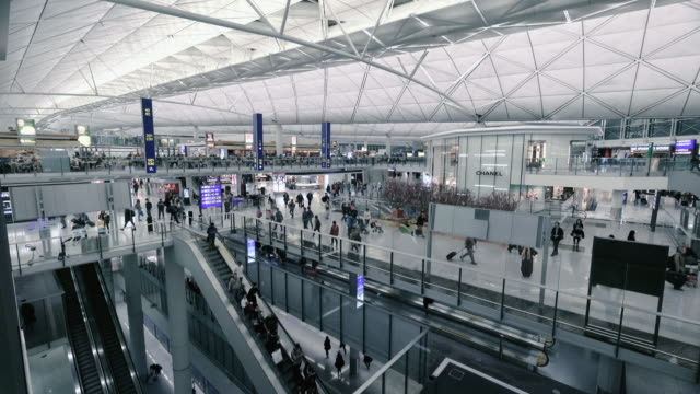 interior of hong kong international airport on chek lap kok island, hong kong - hong kong international airport stock videos and b-roll footage