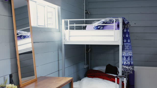 Interior of hostel dormitory with bunk beds