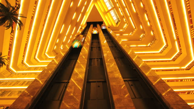 ms pov t/l interior of hotel and  elevator moving up down / doha, qatar - moving down stock videos & royalty-free footage