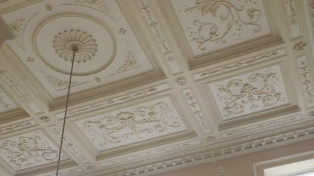 MS PAN Interior of Kelmarsh Hall with designed ceiling / Northamptonshire, England, United Kingdom