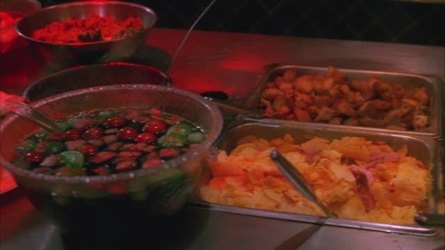 CU Interior of Las Vegas cafeteria, focus on food kept for buffet / Las Vegas, Nevada, USA