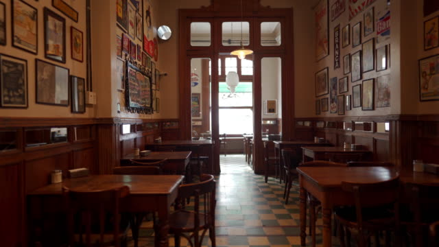 interior of local cafe in buenos aires - stool stock videos & royalty-free footage