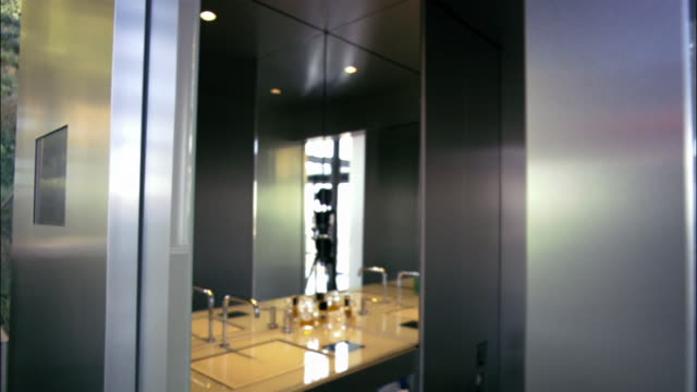 ms, selective focus, interior of modern bathroom - bathroom sink stock videos & royalty-free footage