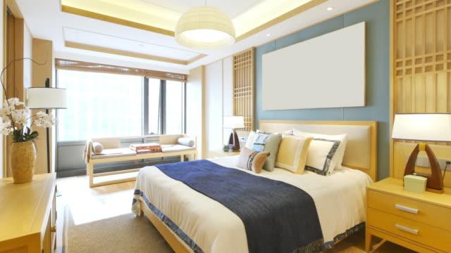 vidéos et rushes de intérieur moderne d'une chambre à coucher - lumière vive
