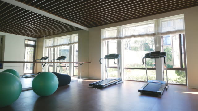interior of modern gym 4k - exercise equipment stock videos and b-roll footage