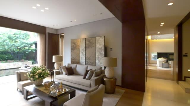 interior of modern living room 4k - living room stock videos & royalty-free footage