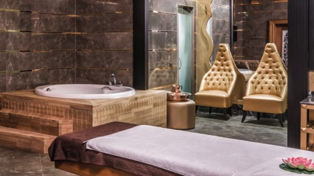 interior of modern spas - massage table stock videos & royalty-free footage