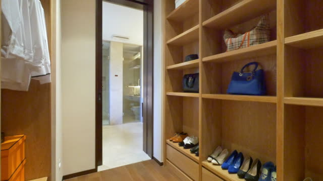 interior of modern wardrobe 4k - rack stock videos & royalty-free footage