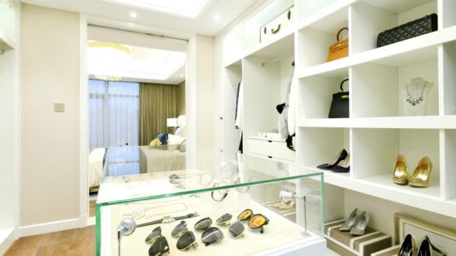interior of modern wardrobe - wardrobe stock videos & royalty-free footage