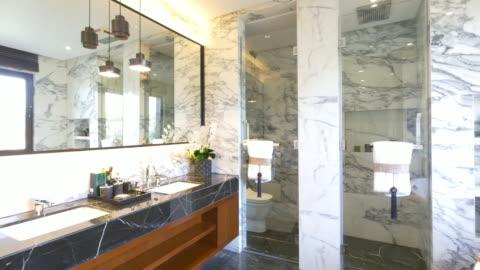 interior of modern washroom 4k - bathroom stock videos & royalty-free footage