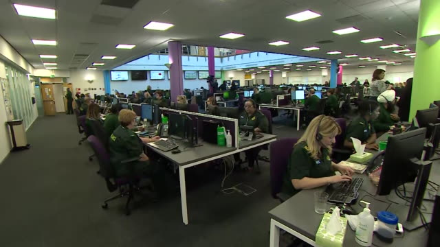 interior of nhs 111 call centre filmed in relation of the increase in calls to the service due to coronavirus - west midlands stock-videos und b-roll-filmmaterial