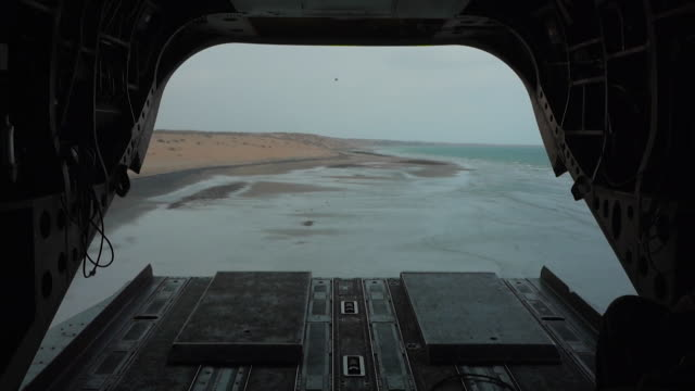 Interior of open back of military helicopter of progovernment troops travelling along Red Sea coast