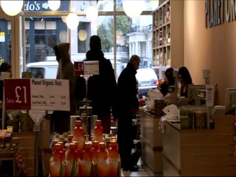 interior of organic supermarket / london united kingdom - アナモルフィック点の映像素材/bロール