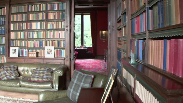 pan interior of personal library in torosay castle / craignure, scotland, united kingdom - stately home stock videos & royalty-free footage