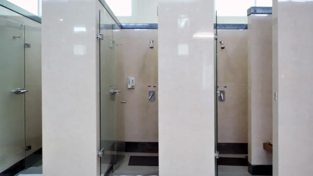 vídeos de stock e filmes b-roll de interior of private restroom.public bathroom washroom.mens restroom in an public building.sports cinemagraphs - casa de banho