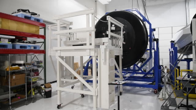 interior of sierra nevada corp. with parts of spaceship being built, louisville, colorado, u.s., on wednesday, july 31, 2019. - スペースシャトル点の映像素材/bロール