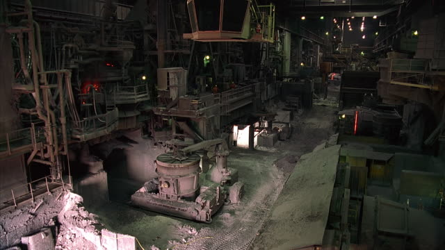 stockvideo's en b-roll-footage met ms interior of steel mill with sparks in background / contrecoeur, quebec, canada - stilstaande camera