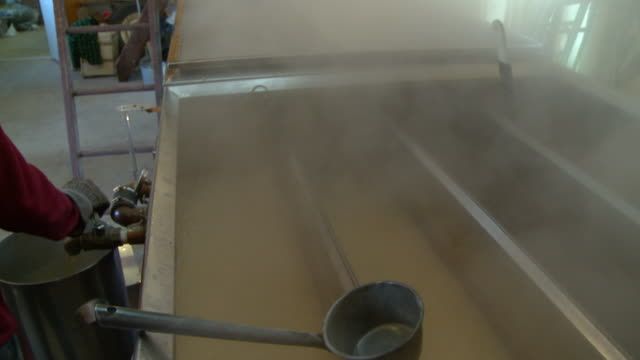 ms tu la interior of sugar cabin, steam rising from boiler with sap to roof vent, north conway, new hampshire, usa - maple syrup stock videos & royalty-free footage