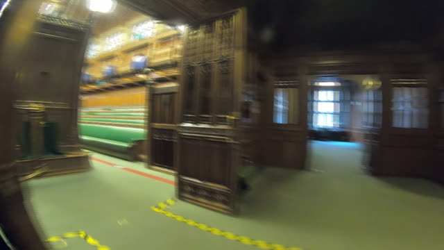 interior point of view walking shots through the houses of parliament into the commons chamber, showing tape on floors to enforce social distancing... - parliament building stock videos & royalty-free footage