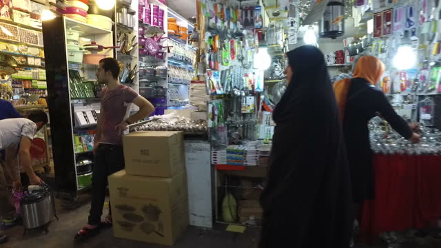 interior point of view walking shots walking past market stalls at a bazaar selling rugs fabric homeware and clothing on july 29 2016 in tehran iran - homeware stock videos and b-roll footage