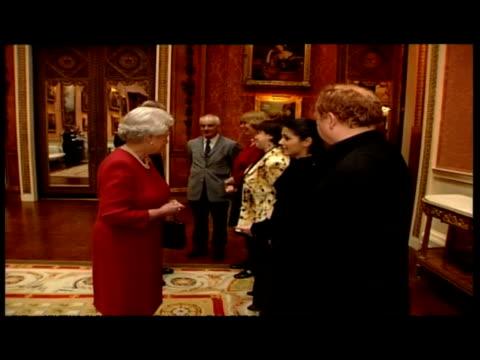 interior queen elizabeth ii & prince philip, duke of edinburgh talking to line of celebrity musicians including katie melua & composer mike batt.... - british royalty stock videos & royalty-free footage