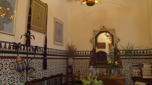 TU interior room with tiled walls and woo beam ceiling in historic building in old Jewish quarter in the historic center of Cordoba