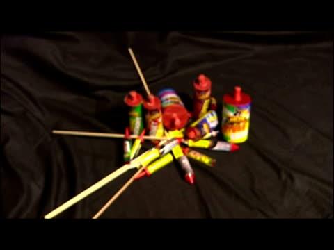 interior set up shots fireworks & anon tearing apart firework to reveal gunpowder. - gunpowder explosive material stock videos & royalty-free footage