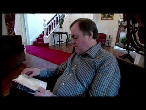 interior set up shots john prescott sits at home reading his autobiography - autobiography stock videos & royalty-free footage