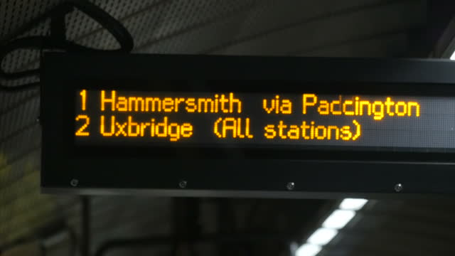 interior shot arrivals board signage on london underground station platform showing trains arriving heading to hammersmith via paddington on the... - tube stock videos & royalty-free footage