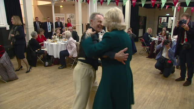 interior shot camilla duchess of cornwall swing dances with members at the royal volunteers service tea party on february 14th 2017 in bristol... - アフタヌーンティー点の映像素材/bロール