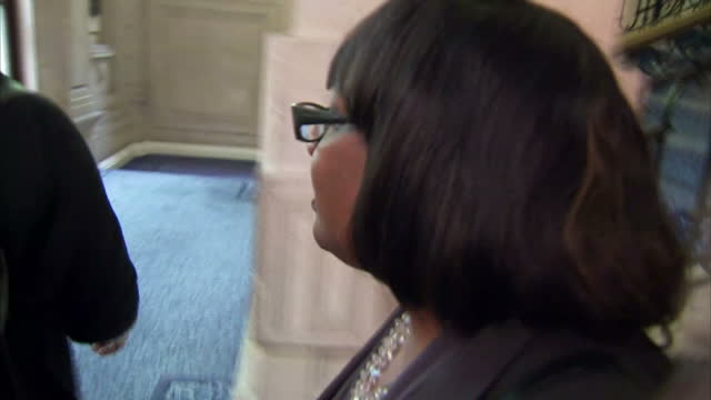 interior shot following diane abbott shadow home secretary up stairs in millbank building doorstepped by the media re her figures on putting 10000... - diane abbott stock videos & royalty-free footage