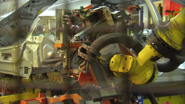 interior shot industrial robots building car as it moves along the production line at the vauxhall assembly plant. on january 21, 2016 in ellesmere... - car plant stock videos & royalty-free footage