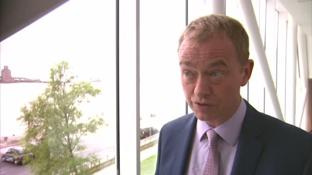 stockvideo's en b-roll-footage met interior shot interview grab with tim farron mp liberal democrats leader re nhs cyber security in southport on monday 15th may 2017 - southport engeland