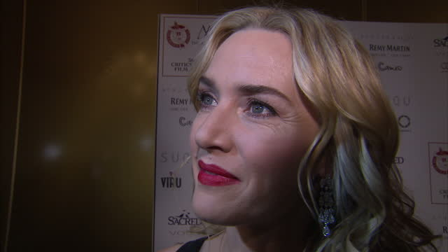 interior shot kate winslet, actress on london critics circle film awards red carpet talking about how it could finally be leonardo dicaprio's year to... - kate winslet stock videos & royalty-free footage