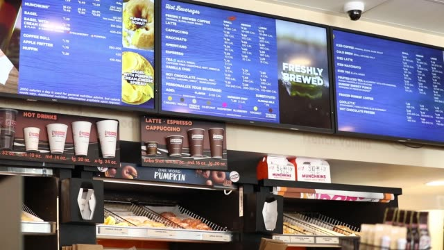 interior shot of a dunkin' donuts showing off menu board and coffee cup sizes in los angeles ca on august 6 2017 photographer patrick fallon shots cu... - coffee drink stock videos and b-roll footage