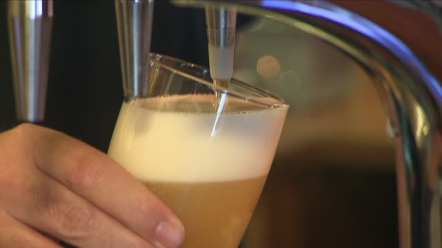 Interior shot of a pint of lager being poured from beer pump into glass on 20th June 2018 Hook Norton England