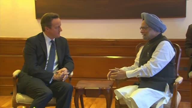 Interior shot of British Prime Minister David Cameron speaking to Manmohan Singh Indian Prime Minister at a bilateral meeting in New Delhi David...