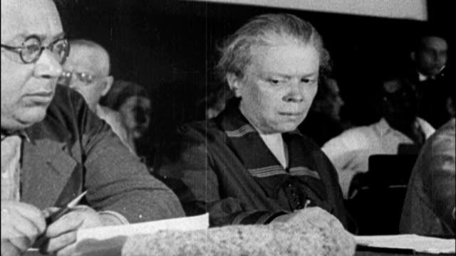 / Interior shot of Nickolai Bukhanin leader of Communist International speaking to packed crowd of Soviet newspapermen / Lenin's sister Anna Ulyanova...