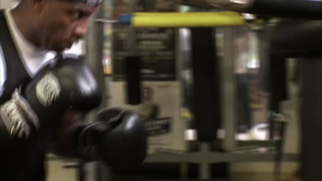 interior shot of nigel benn training ahead of comeback fight in novemeber vs sakio bika - punch bag stock videos & royalty-free footage