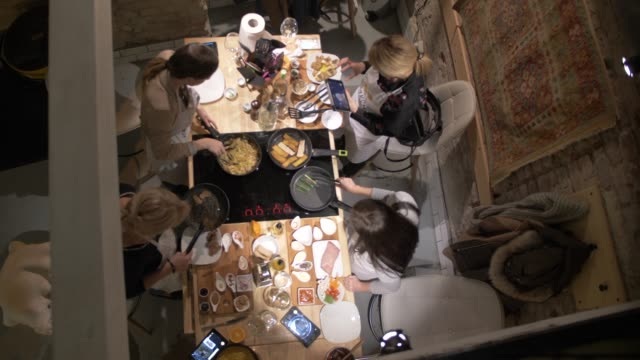interior shot of people cooking in do it yourself restaurant, budapest, hungary, europe - garkochen stock-videos und b-roll-filmmaterial