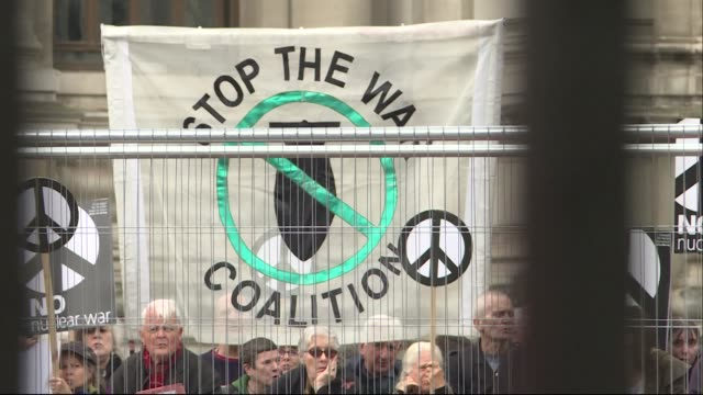 interior shot of prince william about to depart westminster abbey and exterior shot of antinuclear protesters with banners as the new secretary of... - segretario della difesa video stock e b–roll