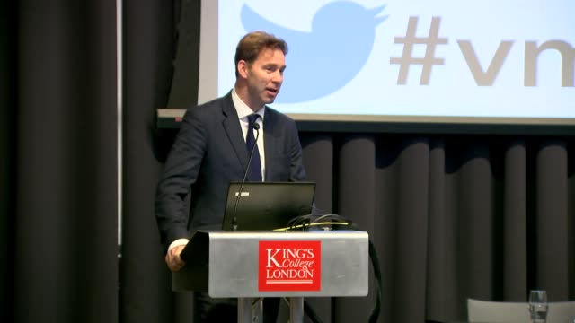 vídeos de stock e filmes b-roll de interior shot of tobias ellwood mp minister for defence people and veterans speaking during the veterans' mental health conference at king's college... - king's college