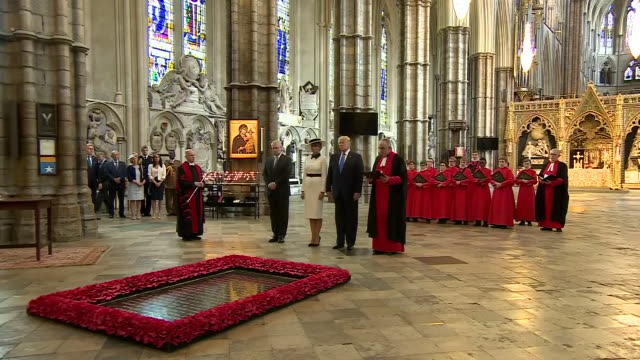 interior shot of us president donald trump and first lady melania trump lay a wreath at the grave of the unknown warrior at the westminster abbey... - tomb of the unknown warrior westminster abbey stock videos & royalty-free footage