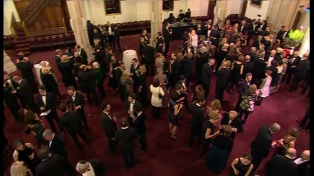 interior shot pan across guests in the foyer there for the man booker prize on october 14 2014 in london england - booker prize stock-videos und b-roll-filmmaterial
