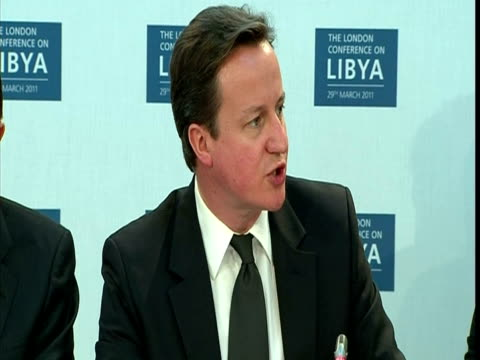 vídeos de stock e filmes b-roll de interior shot prime minister david cameron addresses the libya conference david cameron has warned world leaders that while they meet to discuss the... - 50 segundos ou mais
