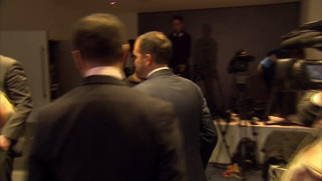 london interior shot prince ali of jordan fifa vice president leaving presser pausing to greet unknown - vice president stock videos & royalty-free footage