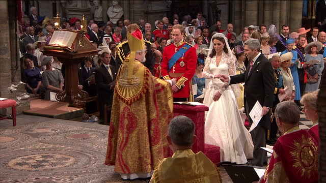 interior shot prince william catherine middleton exchange their wedding vows in front of the archbishop of canterbury interior close up shot prince... - prinz william herzog von cambridge stock-videos und b-roll-filmmaterial