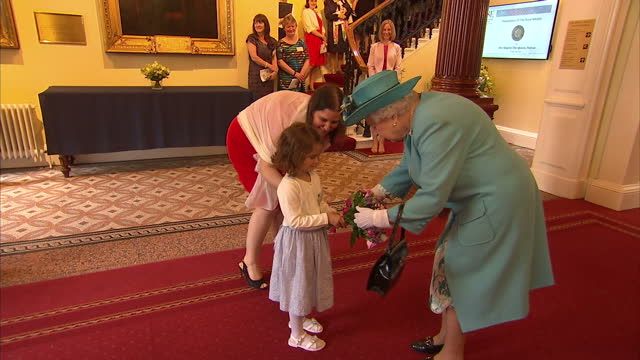 interior shot queen elizabeth ii visits the royal society of edinburgh meet and greet talks to young girl who gives her flowers in edinburgh scotland... - meet and greet stock videos and b-roll footage