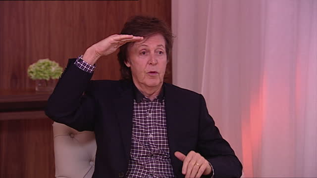 interior shot sir paul mccartney, former member of the beatles, talks about miley cyrus. he says he doesn't think her twerking moves are explicit at... - paul mccartney stock videos & royalty-free footage